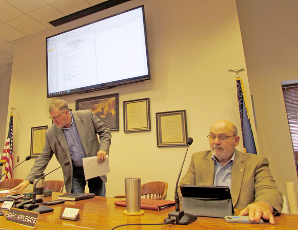Rod Rose The Lebanon Reporter<br /> MEETING ROOM UPGRADE: Commissioners Donnie Lawson (left) and Marc Applegate prepare for Monday's meeting as the agenda is displayed on one of three large monitors recently installed in the Connie Lamar Meeting Room at the Boone County Office Building.