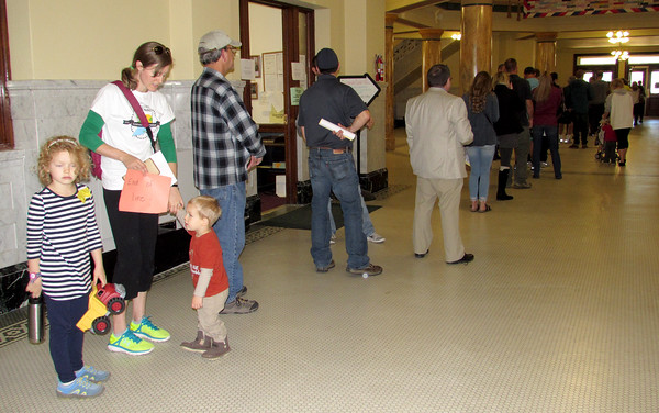 Rod Rose The Lebanon Reporter LAST IN LINE:  Sarah Delaney, with children Lucy and Michael, holds a paper declare her to be the end of the line for early voting Monday in the Boone County Courthouse.