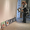FIRST COME, FIRST HUNG ACCEPTS ENTRIES<br /> Elizabeth Pearl | The Lebanon Reporter<br /> NEW EXHIBITION: Cynthia Young, executive director of the SullivanMunce Cultural Center, arranges the first entries to the annual First Come, First Hung exhibition. The first 40 entries to bring their art to the center on Saturday were accepted for the show, which will run at SullivanMunce from Dec. 3 through Dec. 17. The exhibit includes paintings, photography, sculpture, ceramics and other mediums, many of which will be available for sale. Two of the works will recieve People's Choice prizes, in the adult and youth category, from the center, with a prize of $50 each.