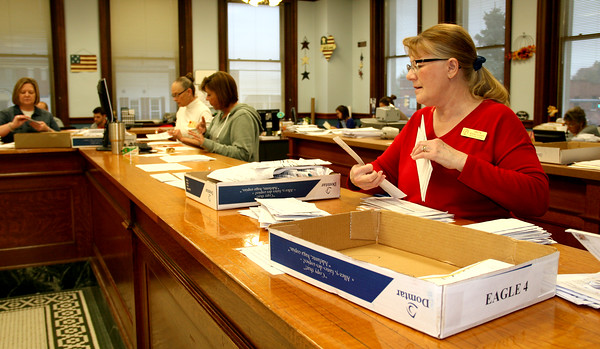 Rod Rose The Lebanon Reporter<br /> TALLYING THE TALLY: Boone County deputy clerks (from left) Doris Wireman, VIckie Wilson, Lisa Morgan and Anita Jones prepare absentee ballots for counting Tuesday afternoon in the Boone County Clerk's Office.