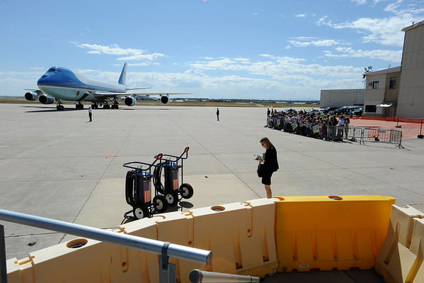 President Barack Obama arriving at Buckley Air Force Base in Aurorar, Colorado. While in Denver, the President will visit Abraham Lincoln High School to highlight his American Jobs Act proposal to put workers back on the job by rebuilding and modernizing schools across the country. September 27, 2011. John Prieto/The Denver Post. .