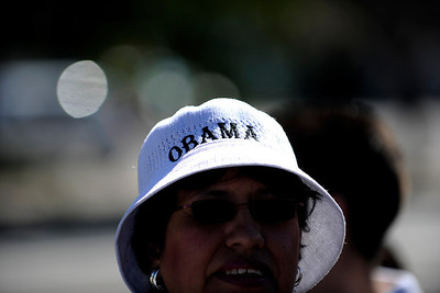 Isabel Nuanez wears a Barack Obama hat as she stands in line before a speech by President Barack Obama at Abraham Lincoln High School on Tuesday, September 27, 2011. AAron Ontiveroz, The Denver Post