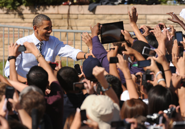 President Barack Obama waves to the crowd, Tuesday Sept. 27, 2011, during his speech at Lincoln High School.  RJ Sangosti, The Denver Post