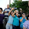 Women hold their cameras up as President Barack Obama is introduced across the street at Abraham Lincoln High School on Tuesday, September 27, 2011. AAron Ontiveroz, The Denver Post
