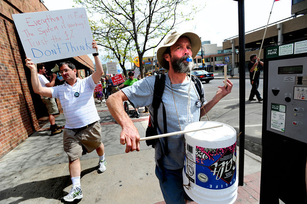 "Frank Hogg plays the drums on a bucket in the Occupy Boulder American Spring Rally in downtown Boulder on Saturday March 31, 2012.<br /> For more photos and a video of the march and rally go to  <a href=""http://www.dailycamera.com"">http://www.dailycamera.com</a><br /> Photo by Paul Aiken"