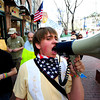 "John, who didn't give his last name, yells into a megaphone on the Pearl Street Mall in the Occupy Boulder American Spring Rally in downtown Boulder on Saturday March 31, 2012.<br /> For more photos and a video of the march and rally go to  <a href=""http://www.dailycamera.com"">http://www.dailycamera.com</a><br /> Photo by Paul Aiken"