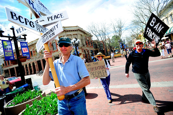 "From left to right Tom Canon, Patricia Eaton and Don Devereux carry signs in the Occupy Boulder American Spring Rally in downtown Boulder on Saturday March 31, 2012.<br /> For more photos and a video of the march and rally go to  <a href=""http://www.dailycamera.com"">http://www.dailycamera.com</a><br /> Photo by Paul Aiken"