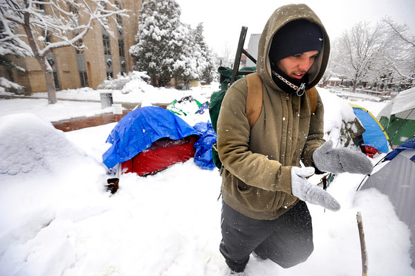 """Kyle Godvey smakes his hands together in the chill at the Occupy Boulder encampement in front of the Boulder County Courthouse on the Pearl Street Mall in Boulder on Thursday December 1, 2011.<br /> For more photos and a video from the site go to  <a href=""""http://www.dailycamera.com"""">http://www.dailycamera.com</a><br /> Photo by Paul Aiken The Camera"""