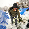 "Zach Freier pitches in with a shovel to clear paths at the Occupy Boulder encampement in front of the Boulder County Courthouse on the Pearl Street Mall in Boulder on Thursday December 1, 2011. <br /> For more photos and a video from the site go to  <a href=""http://www.dailycamera.com"">http://www.dailycamera.com</a><br /> Photo by Paul Aiken The Camera <br /> Photo by Paul Aiken The Camera"