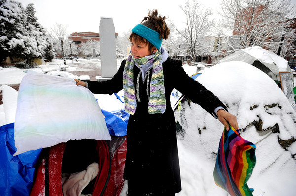 "Darcy Figgs pulls about a frozen pillow at the Occupy Boulder encampement in front of the Boulder County Courthouse on the Pearl Street Mall in Boulder on Thursday December 1, 2011. Figgs said that police repeatedly checked to see if people were sleeping in their tents letting in snow that froze her gear. <br /> For more photos and a video from the site go to  <a href=""http://www.dailycamera.com"">http://www.dailycamera.com</a><br /> Photo by Paul Aiken The Camera <br /> Photo by Paul Aiken The Camera"