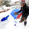 "A woman who asked to be identified as Ginger Riversong, of Boulder finds a pair of boots outside a couple of snow covered tents at the Occupy Boulder encampement in front of the Boulder County Courthouse on the Pearl Street Mall in Boulder on Thursday December 1, 2011. <br /> For more photos and a video from the site go to  <a href=""http://www.dailycamera.com"">http://www.dailycamera.com</a><br /> Photo by Paul Aiken The Camera"