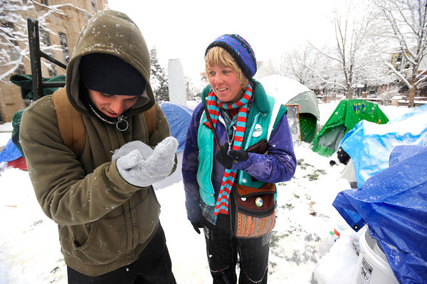 "Kyle Godvey, left and Eva Kirk compare the snowflakes that are falling on them at the Occupy Boulder encampement in front of the Boulder County Courthouse on the Pearl Street Mall in Boulder on Thursday December 1, 2011.<br /> For more photos and a video from the site go to  <a href=""http://www.dailycamera.com"">http://www.dailycamera.com</a><br /> Photo by Paul Aiken The Camera"