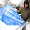 "Kyle Godvey examines a damaged tent smashed by the snow that fell at the Occupy Boulder encampement in front of the Boulder County Courthouse on the Pearl Street Mall in Boulder on Thursday December 1, 2011.<br /> For more photos and a video from the site go to  <a href=""http://www.dailycamera.com"">http://www.dailycamera.com</a><br /> Photo by Paul Aiken The Camera"