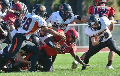 J.S.CARRAS - JCARRAS@DIGITALFIRSTMEDIA.COM Schuylerville defenders swarm Albany Academy's Zeke Thomas (9) during second quarter of high school football action Friday, October 3, 2014 at Albany Academy in Albany, N.Y..