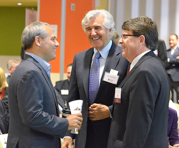 J.S.CARRAS - JCARRAS@DIGITALFIRSTMEDIA.COM    GlobalFoundries Dr. Thomas Caulfield, senior vice president and general manager of Fab 8 talks with former Senator Joseph L. Bruno and F. Michael Tucker, President & CEO of Center for Economic Growth (CEG) during the Center for Economic Growth (CEG) 2014 Annual Member Meeting Thursday, October 23, 2014 at GlobalFoundries in Malta, N.Y..