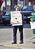 HOLLY PELCZYNSKI - BENNINGTON BANNER <br /> Charlene Adams was among supporters holding signs in support of the rehiring of Jerry O'Connor during a demonstration at the Four Corners in Bennington on Monday, April 2, 2018.