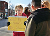 HOLLY PELCZYNSKI - BENNINGTON BANNER <br /> Carol Morin, a secretary at Bennington Elementary School holds a sign in support of Jerry O'Connor at the Four Corners in Bennington on Monday afternoon.