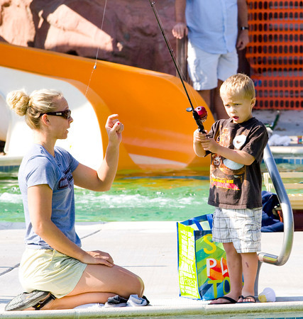 be0927fishing8.jpg Julie Gray and her son Mason, age 5, fish the pool at the Bay Aquatic Center on Saturday morning.  Sept. 21, 2012, during Fishing at the Bay in Broomfield. Photo by Matt Kelley