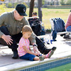 be0927fishing7.jpg Charles Kellogg instructs his granddaughter Elise, age 2, on the finer points of trout fishing at Bay Aquatic Center on Saturday morning. Sept. 21, 2012 during Fishing at the Bay in Broomfield. Photo by Matt Kelley