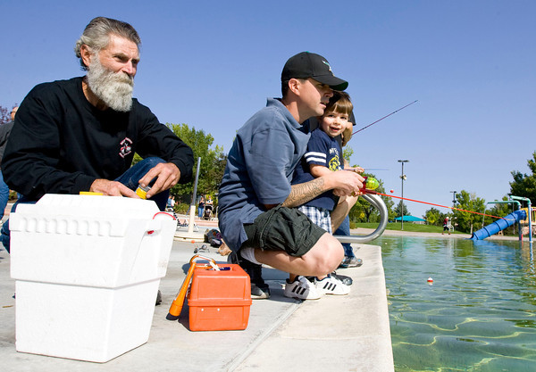 be0927fishing3.jpg Perry Savoie, left, looks on while his grandson Caden, age 2, fishes with his dad Eric at Bay Aquatic Center on Saturday morning, SEpt. 21, 2012, during fishing at the bay in broomfield. Photo by Matt Kelley