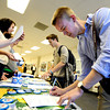 "University of Colorado freshman James Bradbury, right, and junior Cameron Byrd, center, sign in on Wednesday, March 21, during a Greater Together Student Summit at the Duane Physics building on the University of Colorado campus in Boulder. For more photos and video of the event go to  <a href=""http://www.dailycamera.com"">http://www.dailycamera.com</a><br /> Jeremy Papasso/ Camera"