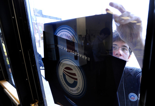 "University of Colorado senior Alex Kumin tapes up a poster supporting President Barack Obama on Wednesday, March 21, during a Greater Together Student Summit at the Duane Physics building on the University of Colorado campus in Boulder. For more photos and video of the event go to  <a href=""http://www.dailycamera.com"">http://www.dailycamera.com</a><br /> Jeremy Papasso/ Camera"