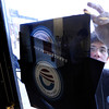 """University of Colorado senior Alex Kumin tapes up a poster supporting President Barack Obama on Wednesday, March 21, during a Greater Together Student Summit at the Duane Physics building on the University of Colorado campus in Boulder. For more photos and video of the event go to  <a href=""""http://www.dailycamera.com"""">http://www.dailycamera.com</a><br /> Jeremy Papasso/ Camera"""
