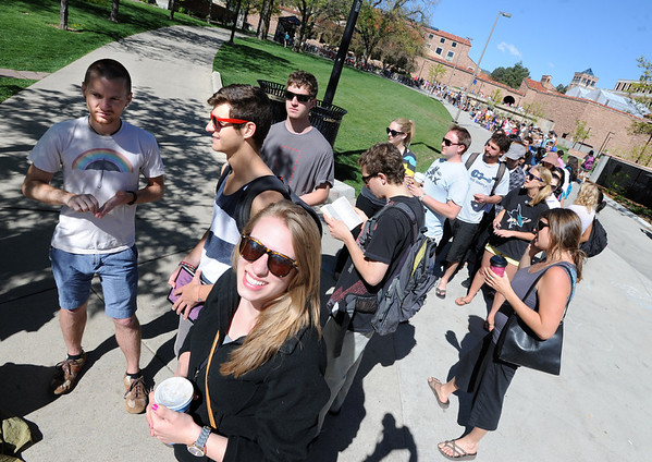 """Kelsey Veeder, bottom center, was among thousands of CU students waiting in line for one of  5,000 tickets available.<br /> Thousands of University of Colorado students lined up around the UMC Sunday to get tickets to the speaking engagement of President Barack Obama Tuesday at the Coors Events Center. For more photos and a video of the students, go to  <a href=""""http://www.dailycamera.com"""">http://www.dailycamera.com</a>.<br /> Cliff Grassmick / April 22, 2012"""
