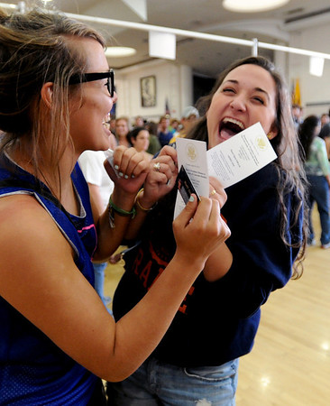 Kenzie Knop, left, and Amalia Arguello, are excited about getting their Obama tickets, after waiting several hours.<br /> Thousands of University of Colorado students lined up around the UMC Sunday to get tickets to the speaking engagement of President Barack Obama Tuesday at the Coors Events Center.<br /> Cliff Grassmick / April 22, 2012