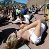 Natashia Rosekrans, bottom, and Jordan Selan, get some sun while waiting in the ticket line.<br /> Thousands of University of Colorado students lined up around the UMC Sunday to get tickets to the speaking engagement of President Barack Obama Tuesday at the Coors Events Center.<br /> Cliff Grassmick / April 22, 2012