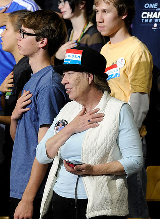 """ReAnn Walters, of Westminster, holds her hand over her heart during the pledge of allegiance inside the Coors Event Center on the University of Colorado campus during President Obama's campaign visit on Thursday, Nov. 1. For more photos and video of the speech go to  <a href=""""http://www.dailycamera.com"""">http://www.dailycamera.com</a><br /> Jeremy Papasso/ Camera"""