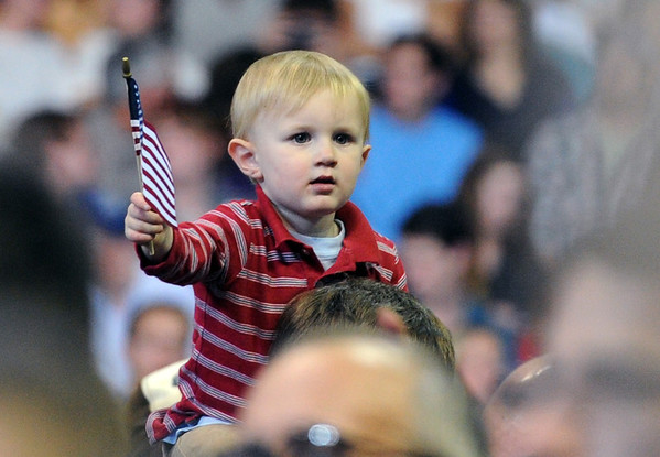 """A young fan gets a good view of the speech.<br /> President Barack Obama speaks to a crowd in the Coors Events Center on the University of Colorado campus on November 1, 2012.<br /> For more photos of Obama, go to  <a href=""""http://www.dailycamera.com"""">http://www.dailycamera.com</a>.<br /> Cliff Grassmick / November 1, 2012"""