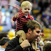 "Theodore Snead, 2, waves the american flag while sitting on his father Keith Snead's shoulders inside the Coors Event Center on the University of Colorado campus during President Obama's campaign visit on Thursday, Nov. 1. For more photos and video of the speech go to  <a href=""http://www.dailycamera.com"">http://www.dailycamera.com</a><br /> Jeremy Papasso/ Camera"