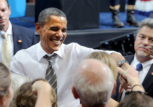 """Barack Obama greets the crowd after his speech Thursday night.<br /> President Barack Obama speaks to a crowd in the Coors Events Center on the University of Colorado campus on November 1, 2012.<br /> For more photos of Obama, go to  <a href=""""http://www.dailycamera.com"""">http://www.dailycamera.com</a>.<br /> Cliff Grassmick / November 1, 2012"""