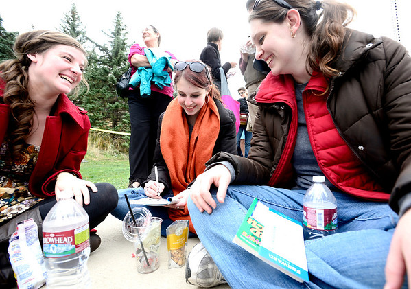 Brenna Morgan (left), Emily Graham (middle) and Audrey Graham (right) work on crossword puzzles while waiting in line to see President Barak Obama at the University Colorado in Boulder, Colorado November 1, 2012.  DAILY CAMERA/ MARK LEFFINGWELL