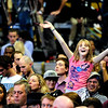 A girl waves her hands while waiting for President Barack Obama to speak to a crowd in the Coors Event Center at the University of Colorado campus in Boulder on Thursday Nov. 1, 2012. DAILY CAMERA/ JESSICA CUNEO.