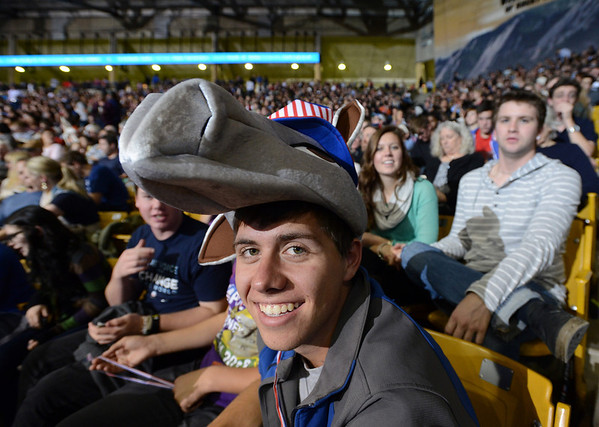 "Connor Christoffersen, a student at Silver Creek High School, wears his demo donkey with pride while waiting for the President to speak.<br /> People gather inside the Coors Events Center to hear President Barack Obama speak tonight.<br /> For more photos of Obama, go to  <a href=""http://www.dailycamera.com"">http://www.dailycamera.com</a>.<br /> Cliff Grassmick / November 1, 2012"
