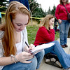 Toni Deigeronima, freshman in speech language sciences, studies for a speech disorder class test while waiting in line to see President Barak Obama at the University Colorado in Boulder, Colorado November 1, 2012.  DAILY CAMERA/ MARK LEFFINGWELL