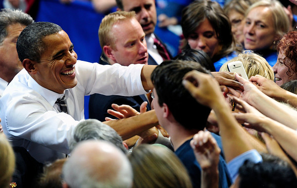 President Barack Obama shakes hands after speaking to a crowd in the Coors Event Center at the University of Colorado campus in Boulder on Thursday Nov. 1, 2012. DAILY CAMERA/ JESSICA CUNEO.