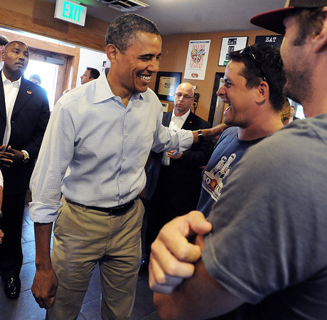 """President Barack Obama jokes with Tom Smith and other customers at the Buff Restaurant in Boulder on Sunday  September 2, 2012.<br /> For more photos and a video of Obama, go to  <a href=""""http://www.dailycamera.com"""">http://www.dailycamera.com</a>.<br /> Cliff Grassmick  / September 2, 2012"""