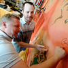 """Tylan Gilbert, Left and Galen Faris, both regulars at The Sink, discuss the possibilities of the artwork that could surround the signature of President Barack Obama, who visited the Sink yesterday.<br /> For more photos and a video of the sink, go to  <a href=""""http://www.dailycamera.com"""">http://www.dailycamera.com</a>.<br /> Cliff Grassmick / April 25, 2012"""