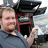"Dan Williams holds up yesterday's Daily Camera with the photo of himself shaking the hand of President Barack Obama during his visit to The Sink on The Hill.<br /> For more photos and a video of the sink, go to  <a href=""http://www.dailycamera.com"">http://www.dailycamera.com</a>.<br /> Cliff Grassmick / April 25, 2012"