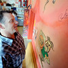 """Mark Heinritz, co-owner of The Sink restaurant in Boulder, gets a closer look at the signature of President Barack Obama.<br /> For more photos and a video of the sink, go to  <a href=""""http://www.dailycamera.com"""">http://www.dailycamera.com</a>.<br /> Cliff Grassmick / April 25, 2012"""