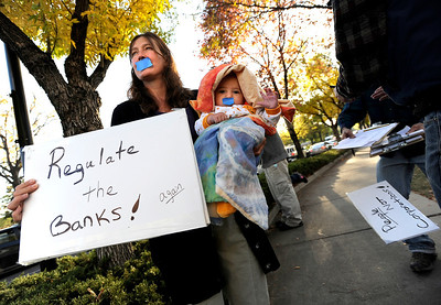 "Kathleen Haggerty, of Boulder, and her son Ari Sands, wear tape over their mouths while protesting on Friday, Oct. 14, during the ""Occupy Boulder"" rally near the intersection of Canyon Boulevard and 26th Street in Boulder. For more photos of the rally go to www.dailycamera.com Jeremy Papasso/ Camera"