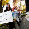 "Kathleen Haggerty, of Boulder, and her son Ari Sands, wear tape over their mouths while protesting on Friday, Oct. 14, during the ""Occupy Boulder"" rally near the intersection of Canyon Boulevard and 26th Street in Boulder. For more photos of the rally go to  <a href=""http://www.dailycamera.com"">http://www.dailycamera.com</a><br /> Jeremy Papasso/ Camera"