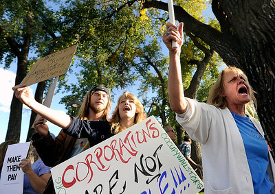"Jennifer Williamson, of Longmont, right, and Emily Coffee, of Lafayette, middle, chant ""we are the 99 percent"" on Friday, Oct. 14, during the ""Occupy Boulder"" rally near the intersection of Canyon Boulevard and 26th Street in Boulder. For more photos of the rally go to www.dailycamera.com Jeremy Papasso/ Camera"