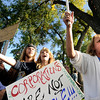 "Jennifer Williamson, of Longmont, right, and Emily Coffee, of Lafayette, middle, chant ""we are the 99 percent"" on Friday, Oct. 14, during the ""Occupy Boulder"" rally near the intersection of Canyon Boulevard and 26th Street in Boulder. For more photos of the rally go to  <a href=""http://www.dailycamera.com"">http://www.dailycamera.com</a><br /> Jeremy Papasso/ Camera"