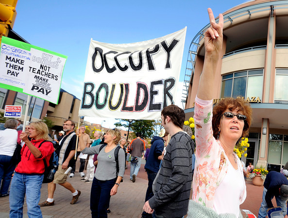 """Lisa Powers, of Boulder, right, holds up a peace sign while  protesting with others on Saturday, Oct. 15, during the """"Occupy Boulder"""" rally near the intersection of Canyon Boulevard and Broadway in Boulder. For more photos and a video of the rally go to  <a href=""""http://www.dailycamera.com"""">http://www.dailycamera.com</a><br /> Jeremy Papasso/ Camera"""