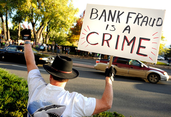"Terry Frazier, of Broomfield, holds up a protest sign to passing cars on Friday, Oct. 14, during the ""Occupy Boulder"" rally near the intersection of Canyon Boulevard and 26th Street in Boulder. For more photos of the rally go to  <a href=""http://www.dailycamera.com"">http://www.dailycamera.com</a><br /> Jeremy Papasso/ Camera"