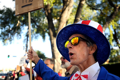 "Richard DiIlio, of Boulder, chants while dressed as Uncle Sam on Friday, Oct. 14, during the ""Occupy Boulder"" rally near the intersection of Canyon Boulevard and 26th Street in Boulder. For more photos of the rally go to www.dailycamera.com Jeremy Papasso/ Camera"